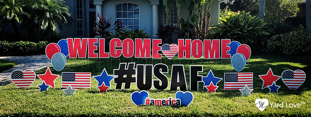 welcome home #USAF yard love signs in a yard celebrating a veteran coming home