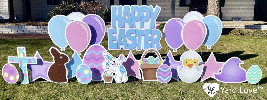 Happy Easter yard sign with balloon signs and lots of other little spring and easter graphic signs from Yard Love in a yard