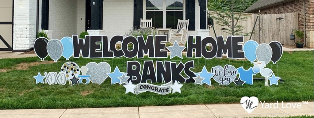 Yard sign that reads welcome home banks